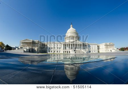Washington DC, US Capitol Building and mirror reflection over glass dome East facade