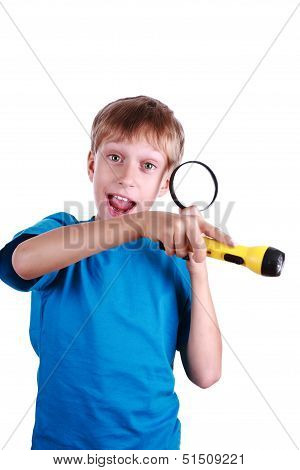 Beautiful blond boy in a in a blue t-shirt holds a flashlight and a magnifying glass searching