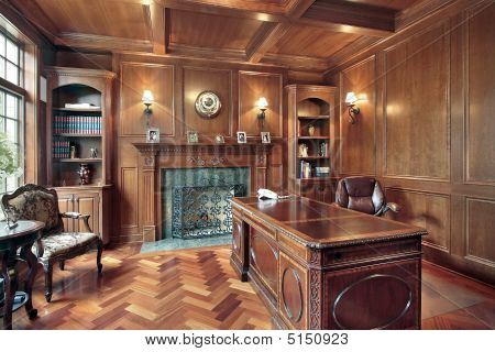Wood Paneled Office With Fireplace