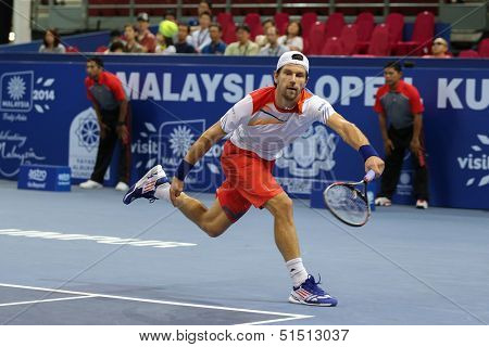 KUALA LUMPUR - SEPTEMBER 28: Jurgen Melzer plays a return to Joao Sousa in a semi-final match of the Malaysia Open 2013 tennis played at the Putra Stadium, Malaysia on September 28, 2013.