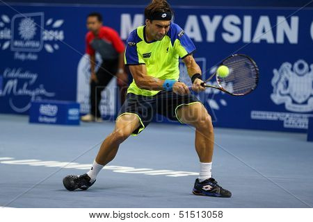 KUALA LUMPUR - SEPTEMBER 27: David Ferrer plays a return to Joao Sousa in a quarter-final match of the Malaysia Open 2013 tennis played at the Putra Stadium, Malaysia on September 27, 2013.