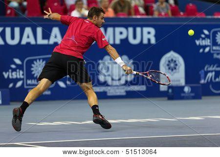 KUALA LUMPUR - SEPTEMBER 27: Stan Wawrinka plays a return to Dimitry Tursunov during a quarter-final match at the Malaysia Open 2013 tennis played at the Putra Stadium, Malaysia on September 27, 2013.