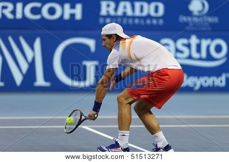 KUALA LUMPUR - SEPTEMBER 28: Jurgen Melzer volleys a return to Joao Sousa in a semi-final match of the Malaysia Open 2013 tennis played at the Putra Stadium, Malaysia on September 28, 2013.
