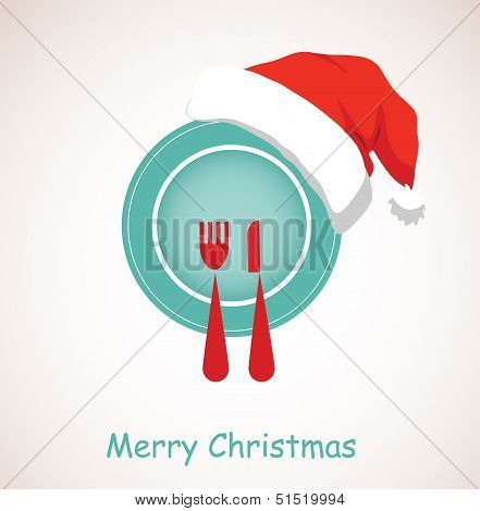 christmas dinner. plate wearing christmas red hat
