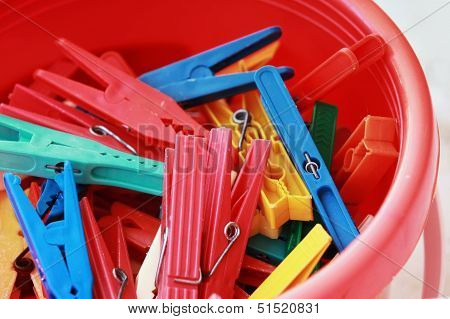 Colorful Plastic Clothespins In The Bucket