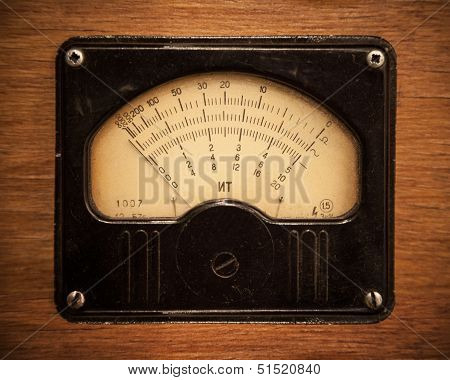 Close-up Photo Of An Vintage Electric Multimeter On Wooden Panel