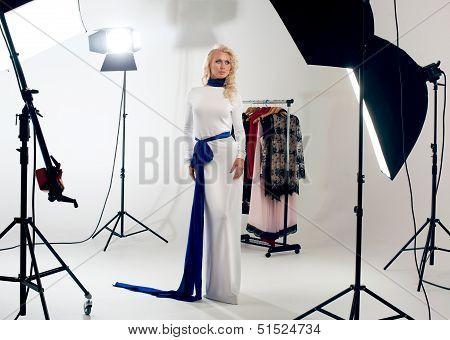 Blonde Posing Against A Professional Studio