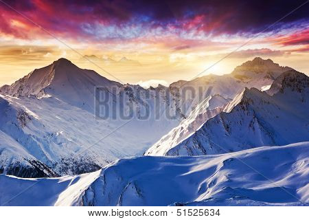 Fantastic evening winter landscape. Colorful overcast sky. Austria, Europe. Beauty world.