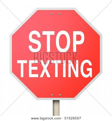 A red octogon shapped sign reading Stop Texting to illustrate the danger of text messaging while in a car and causing accidents from distracted driving