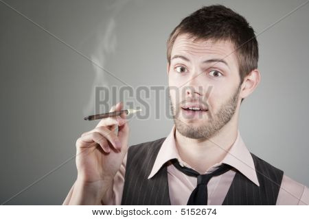 Happy Young Man With Small Cigar
