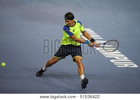KUALA LUMPUR - SEPTEMBER 25: David Ferrer (Spain) hits a backhand return in a first round tennis match at the Malaysia Open 2013 played at the Putra Stadium, Malaysia on September 25, 2013.