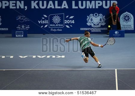 KUALA LUMPUR - SEPTEMBER 24: Alex Bogomolov Jr. (Russia) hits a backhand return in a first round tennis match at the Malaysian Open 2013 played at the Putra Stadium, Malaysia on September 24, 2013.
