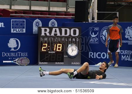 KUALA LUMPUR - SEPTEMBER 29: Joao Souso (Portugal) reacts after winning the final point and the match of singles final of the Malaysian Open 2013 in Putra Stadium, Malaysia on September 29, 2013.