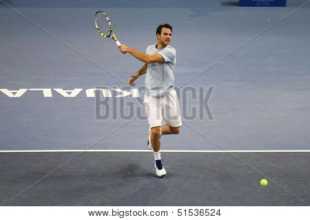 KUALA LUMPUR - SEPTEMBER 25: Adrian Mannarino (France) hits a forehand return in a first round tennis match at the Malaysia Open 2013 played at the Putra Stadium, Malaysia on September 25, 2013.
