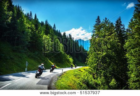 Bikers in mountainous tour, traveling across Europe, curve highway in mountains, scene destinations, extreme transport, active lifestyle