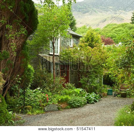 garden at the front of old house, Lake District, Cumbria, UK.