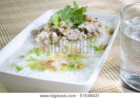 Soft-boiled Rice Pork With Glass Of Water