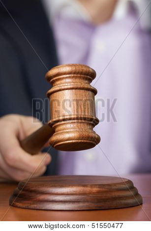 auctioneer with wooden gavel