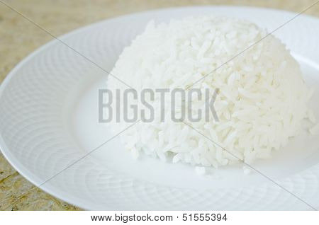 Steamed White Rice From Jasmin Rice With Fork On The White Plate.
