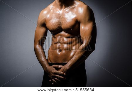Ripped young man in bodybuilding concept