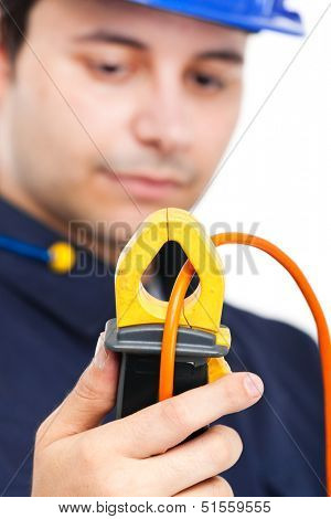 Electrician looking at a tester
