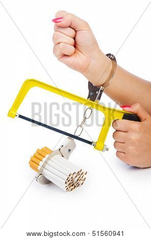 Addiction concept with cigarettes and handcuffs