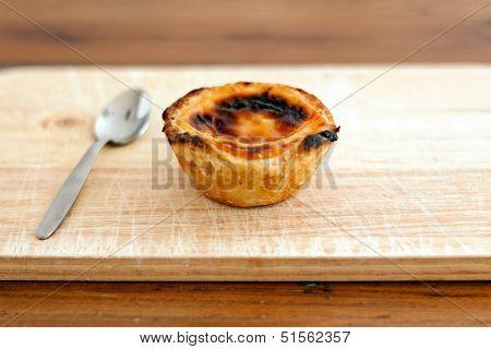 Pastel de nata Portugeuese custard tart with spoonb