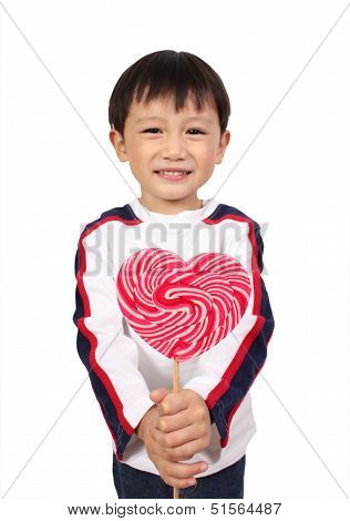 Young boy holding lollipop