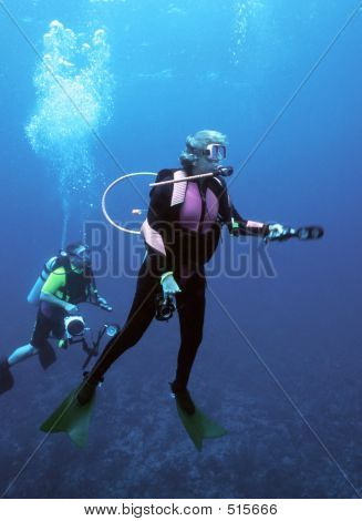 Female Diver Surfacing