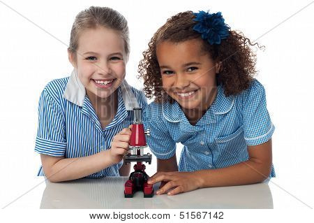 Kids In Uniform Playing With Microscope