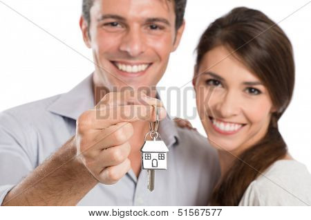 Happy Smiling Young Couple Showing Key Of Their New House Isolated On White Background
