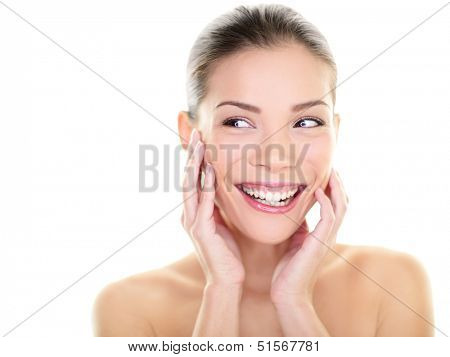 Beauty skin care woman looking at side laughing happy. Skincare asian beautiful woman touching face and perfect skin looking away for body care product advertisement. Multi-ethnic Asian girl fresh.