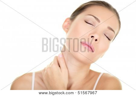 Neck pain muscle stress and strain - Unhappy tense stressed Asian woman massaging neck. Massage and wellness concept with female beauty model isolated on white background. Mixed race Asian Caucasian.