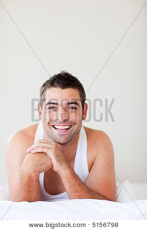 Man In Bed Smiling To The Camera