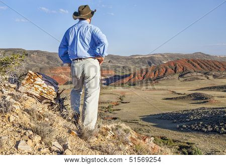 male hiker contemplates a scenery of Red Mountain Open Space in northern Colorado near Fort Collins