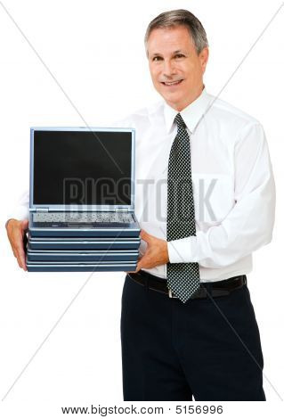 Businessman Holding Stack Of Laptops