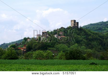 Old Medieval Village With A Castle In France