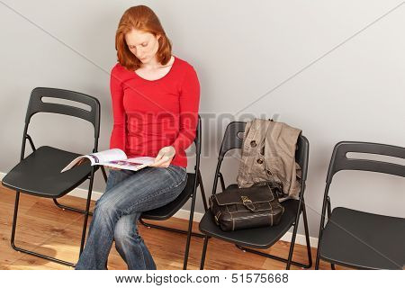 A Young Person Reading A Magazine