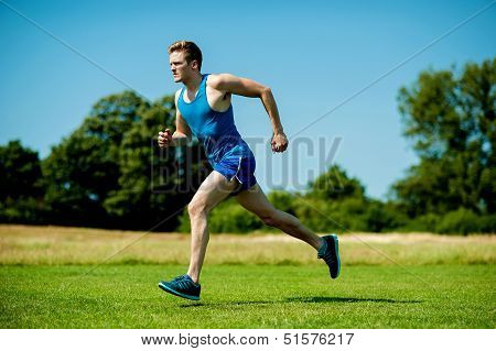 Fit Athlete Running Hard On A Sunny Day