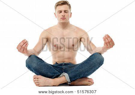 Shirtless Young Man Doing Meditation