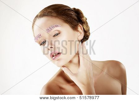 Faceart. Portrait Of Young Beauty With Bright Eyebrows