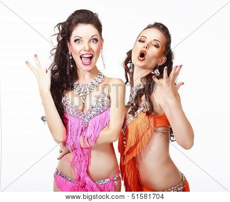 Belly Dance. Two Women In Oriental Stage Costumes Singing