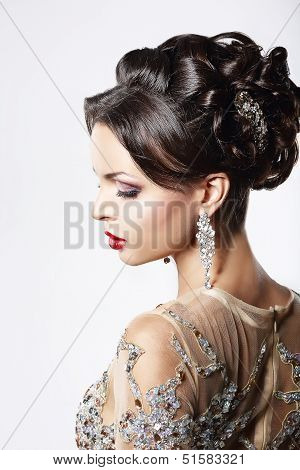 Profile Of Classy Brown Hair Lady With Jewelry And Festive Hairstyle
