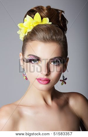 Eccentric Showy Woman With Vivid Colorful Makeup And False Long Eyelashes