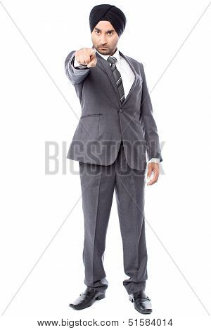 Angry Businessman Pointing Towards You