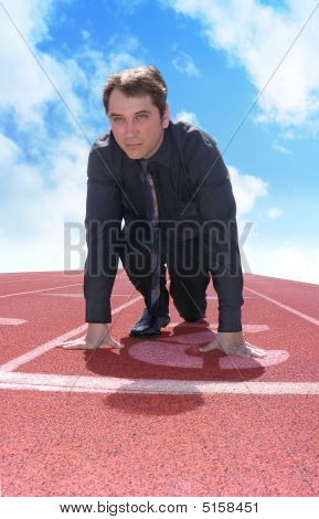 Business Man On A Track With Clouds