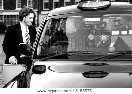Male Passenger Communicating With Taxi Driver