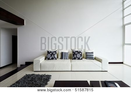 Interior design series: Modern living room with big empty white wall