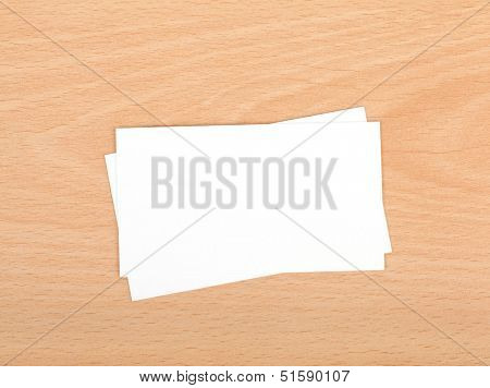 Blank business cards on wooden office table