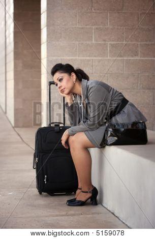 Bored Hispanic Woman Traveler